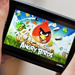 playing angry birds game on smartphone